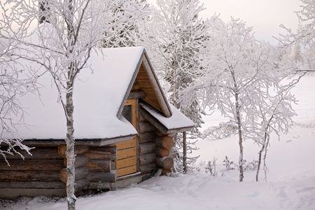 cozy wooden cottage in snowy winter forest Stock Photo - 3118143