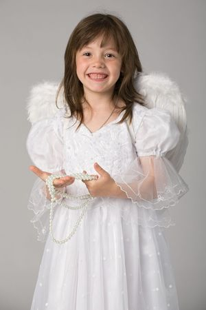 baby girls smiley face: little girl in white dress and angel wings