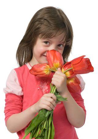 divertida niña con flores en las manos aisladas en blanco  Foto de archivo