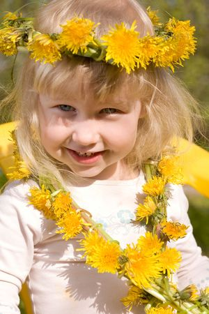 little girl in flower wreath close-up portrait photo