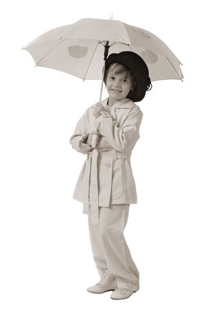 funny girl in fashioned pink clothes with pink umbrella in hands isolated on white photo