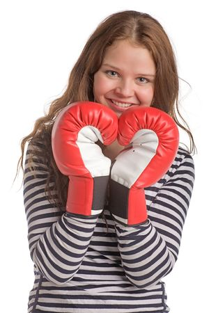 young smiling woman with hands in boxing gloves, isolated on white photo