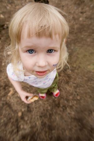 perversion: funny toddler girl looking in lens closeup distortion view