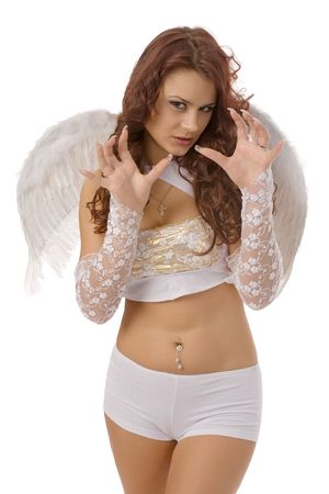 young beautiful woman; in white lingerie and angel wings with evil face and predatory gesture of hands, isolated on white photo