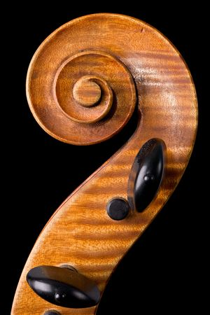 old violoncello close-up isolated on black background photo