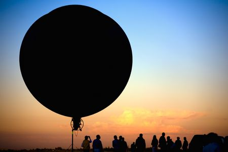 blimp: flying blimp silhouette on colorful sunset background
