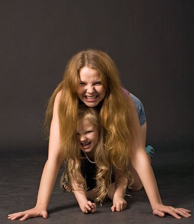 young beautiful long-haired mother and daughter with predatory grin Stock Photo - 3309888