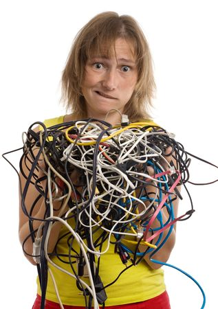 crazy woman with tangle of cables and wires in hands isolated on white photo