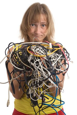 muddle: woman with tangle of cables and wires in hands isolated on white Stock Photo