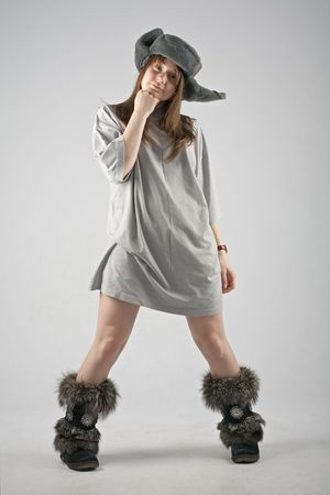 moccasins: funny young woman in russian earflapped fur hat and fur boots Stock Photo
