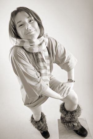 moccasins: smiling young woman in long t-shirt, fur moccasins and striped muffler Stock Photo