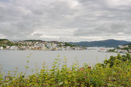 panorama of small beautiful coastal city in rainy afternoon photo