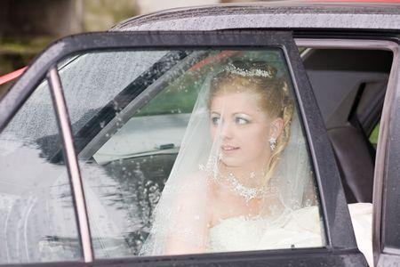 face of beautiful bride in car window closeup photo