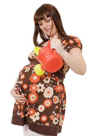 happy pregnant woman portrait with watering can in hands isolated on white background photo
