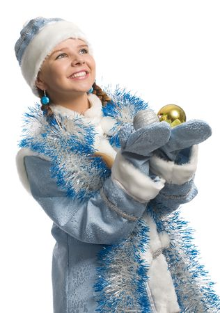 christmas girl with decoration ball in hands looks upward, isolated on white photo