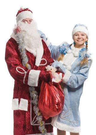 Snow maiden  and Santa Claus with gifts look at camera, isolated on white