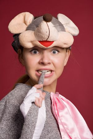 beautiful girl in a mouse costume on a claret background Stock Photo - 3884971