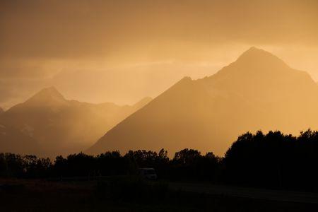 Night landscape of mountain road with sunset orange sky Stock Photo - 3933992