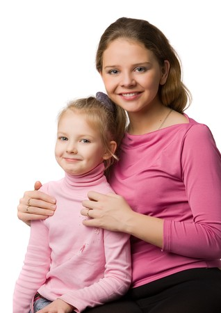 young mother and daughter in pink clothes, isolated on white photo