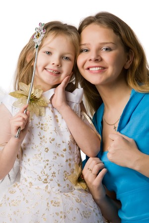 young beautiful mother and daughter in festive dresses and magic wand in hand, isolated on white photo