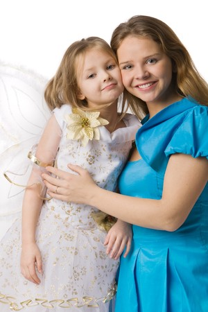 Young mum in beautiful dress embraces daughter in white festive dress with butterfly wings, isolated on white photo