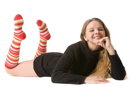 beautiful smiling girl in brown sweater and long red-orange socks lies on floor, isolated on white Stock Photo - 4031211