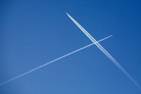 intersect: Two crossing traces from planes in clean blue sky