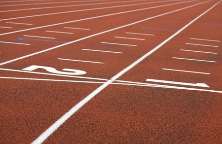 cushioned: Marking  stadium with red covering white lines and numbers