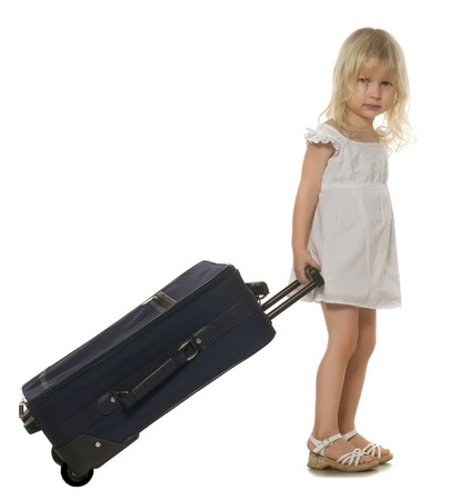 beautiful little girl a white dress carries suitcase, isolated on white photo