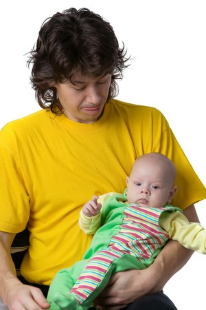father in  yellow T-shirt, with  tongue hanging out, with tenderness looks at  kid lying at it on hands Stock Photo - 4448257