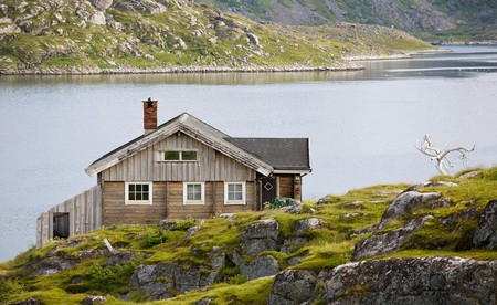 pacification: single wooden house standing on  riverside Stock Photo