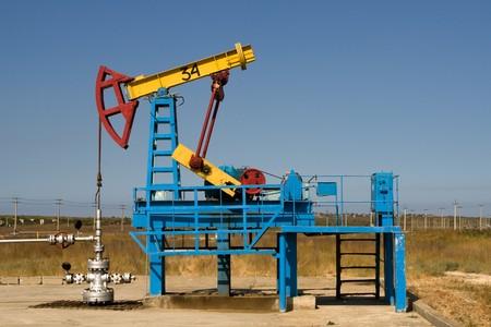 depletion: An industrial oil pump under a blue sky