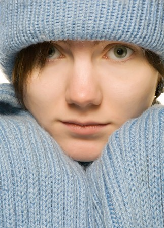 beautiful woman in blue hat and knitted scarf close-up portrait photo