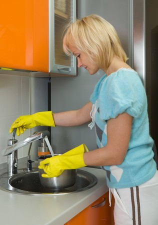 Young woman washing dishes in the kitchen Stock Photo - 4474595