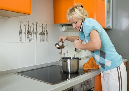 young woman preparing food in modern kitchen photo