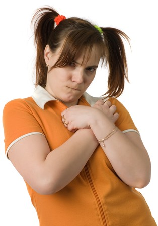 to fold one's arms: Adult girl in orange clothes with a two pony-tail  fold ones arms, isolated on white