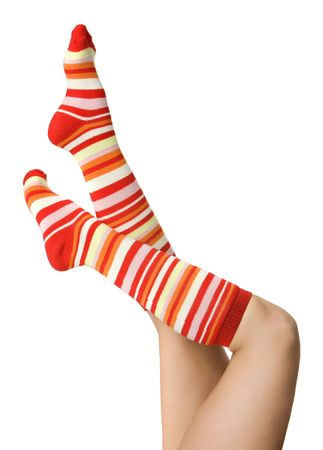 sexy woman legs in striped red socks isolated on white photo