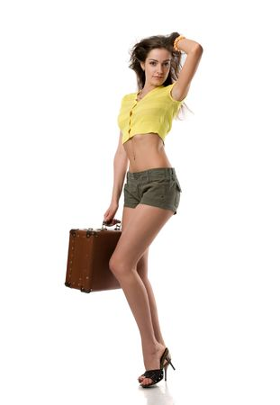 beautiful girl in clothes stands with a suitcase, isolated on white Stock Photo - 4711961