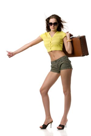 beautiful girl in sunglasses with a suitcase shows a hand stop, isolated on white Stock Photo - 4711917