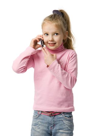 little girl talks by mobile phone, isolated on white photo