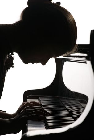 profile of girl playing the grand piano, white and black