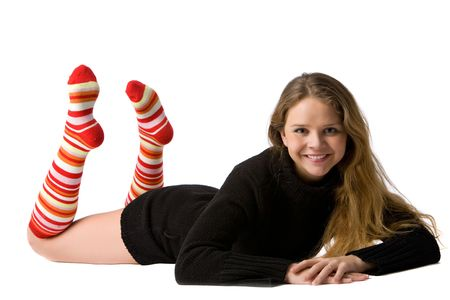 beautiful smiling girl in black sweater and long striped socks lies on the floor, isolated on white Stock Photo - 4751942