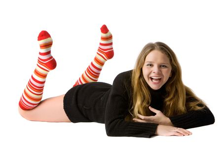 beautiful smiling girl in black sweater and long striped socks lies on the floor, isolated on white Stock Photo - 4767503