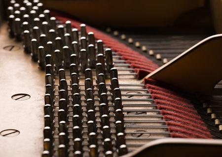 piano closeup: various details inside of grand piano