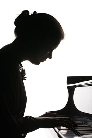 grand piano: silhouette of beautiful girl playing the grand piano, isolated on white Stock Photo