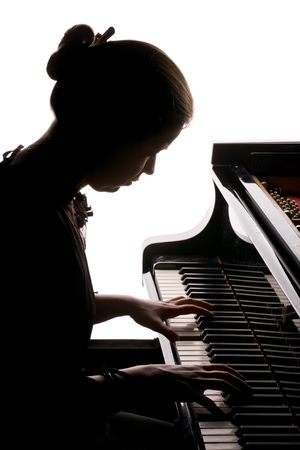 pianist: silhouette of beautiful girl playing the grand piano, isolated on white Stock Photo