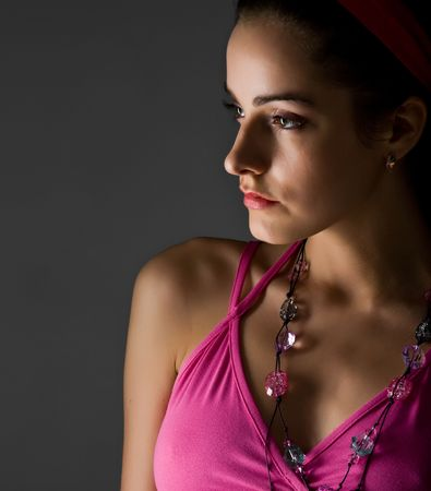 young beautiful woman in pink dress close-up portrait