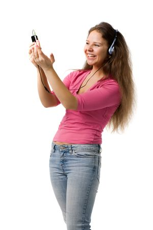 giggle: beautiful laughing girl in headphone looks at PDA, isolated on white Stock Photo