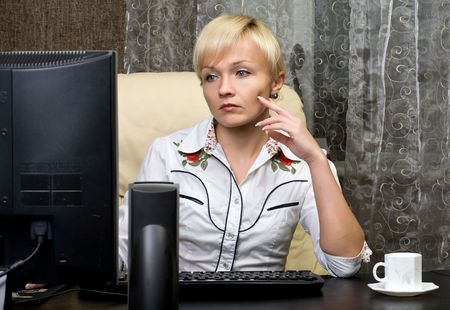 beautiful business woman sit at the table in  office photo