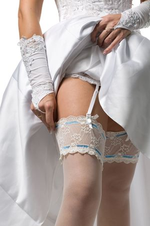 bride dresses stockings on feet, a close up